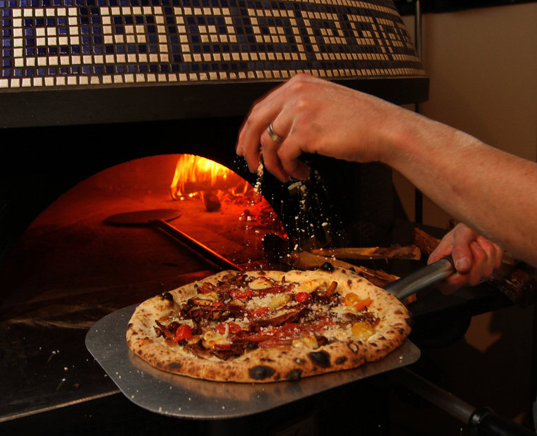 Bar del Corso on Beacon Hill serves deliciously charred, blistered Neapolitan-style pizza.  (Mark Harrison/The Seattle Times)