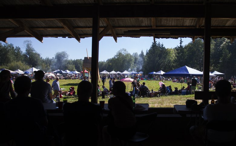 Burning Beast-goers take a break in the shade of a barn at Smoke Farm, which also hosts arts events, a carpentry program for kids called Sawhorse Revolution, educational programs and more. (Lindsey Wasson/The Seattle Times)
