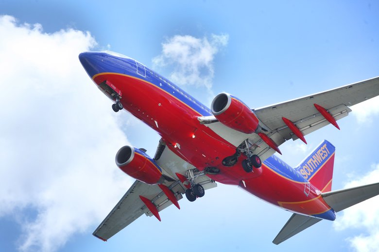 Southwest canceled more than 220 flights Thursday across its system after canceling nearly 700 flights Wednesday when systemwide computer glitches stalled operations. (Skip O'Rourke / The Associated Press)