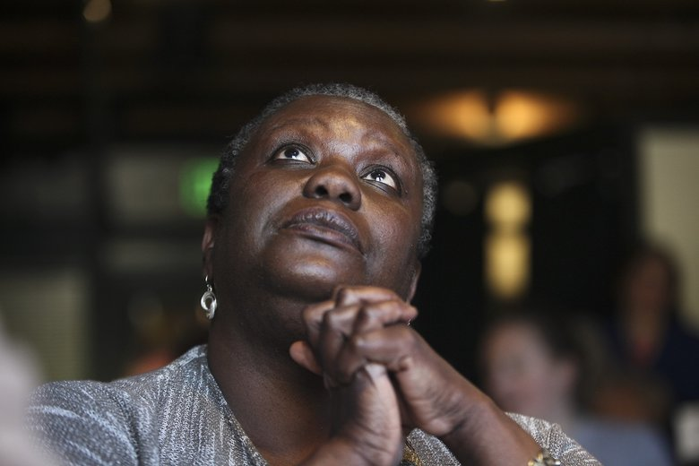 """""""This is historic, I'm thrilled. Whatever happens with the election this is a historical night to celebrate,"""" said Martine Pierre-Louis as she watched the convention.  (Sophia Nahli Allison/The Seattle Times)"""