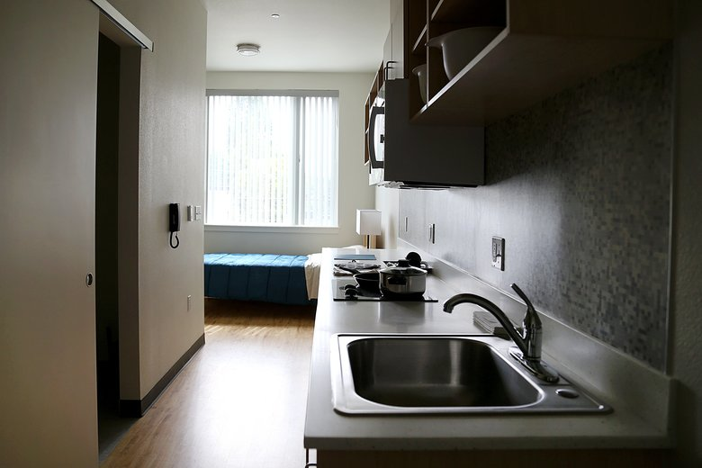 Apartments such as this studio are in the upstairs of the University District Food Bank's new home. (Johnny Andrews/The Seattle Times)