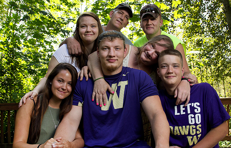 University of Washington offensive lineman Kaleb McGary is surrounded by family members and friends on the Hylebos Wildlife Trail on Wednesday, August 3, 2016, in Fife. Pictured from left to right, surrounding Kaleb McGary, are his girlfriend, Brianna Shannon, sister, Savannah McGary, father, Justin McGary, best friend, Jacob Walker, mother, Cassandra McGary, and brother, Jonah McGary.  (* all names cq *)