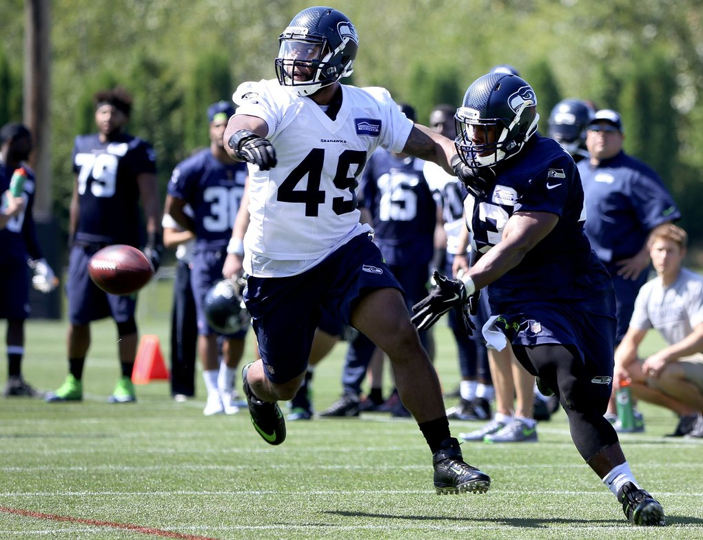 Seattle Seahawks linebacker Kyle Coleman, left, defends running back Cameron Marshall during training camp at the VMAC on Friday. (Johnny Andrews / The Seattle Times)