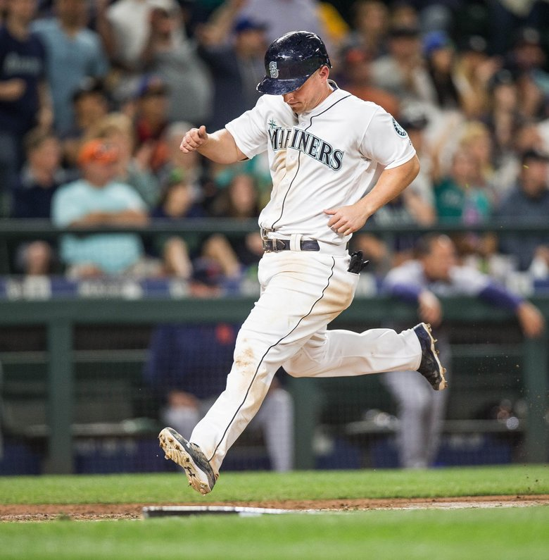 Kyle Seager scores on the Leonys Martin RBI single in the 8th, giving the Mariners a 3-1 lead over Detroit.  (Dean Rutz / The Seattle Times)