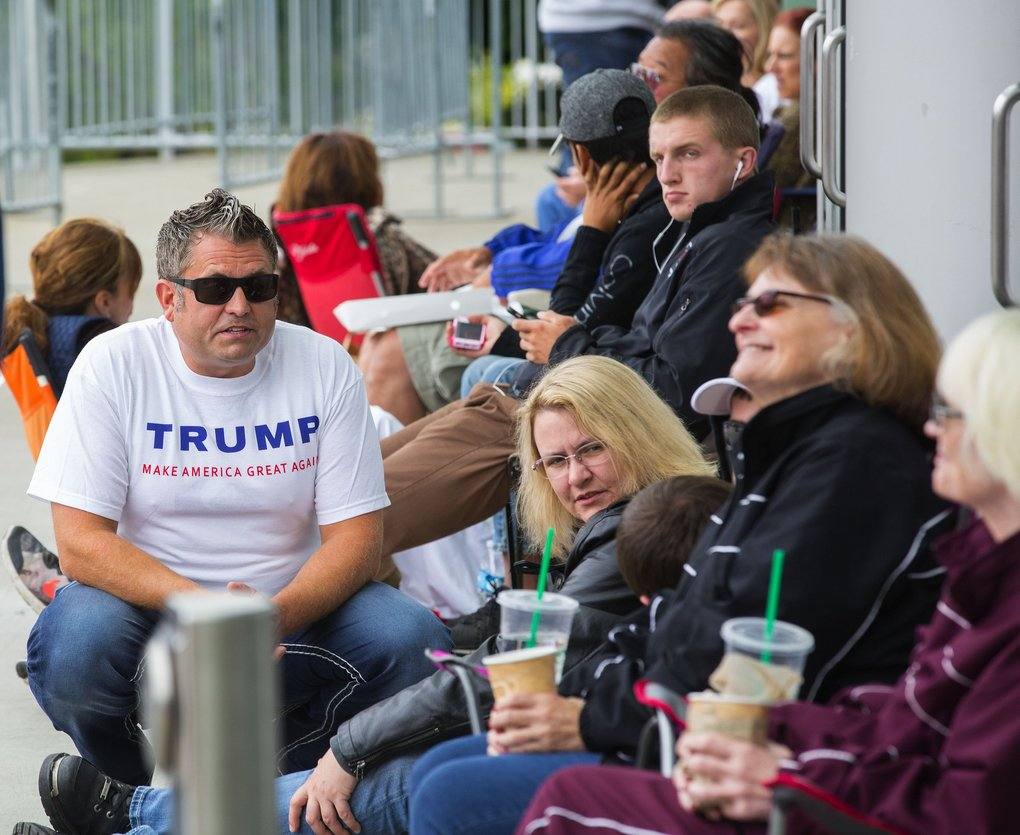 Donald Trump supporters line up in front of Xfinity Arena in downtown Everett early Tuesday morning ahead of the presidential candidate's rally. (Mike Siegel / The Seattle Times)