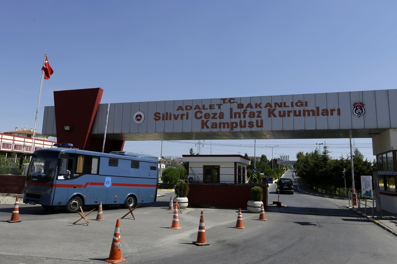 A bus exits from a high security prison complex in Silivri, about 80 kilometers (50 miles) west of Istanbul, Wednesday, Aug. 17, 2016. Turkey issued a decree Wednesday for the conditional release of some 38,000 low level prisoners, Justice Minister Bekir Bozdag said Wednesday, in a move being seen as reducing its prison population to make space for thousands of people arrested following last month's failed coup. (AP Photo/Thanassis Stavrakis)