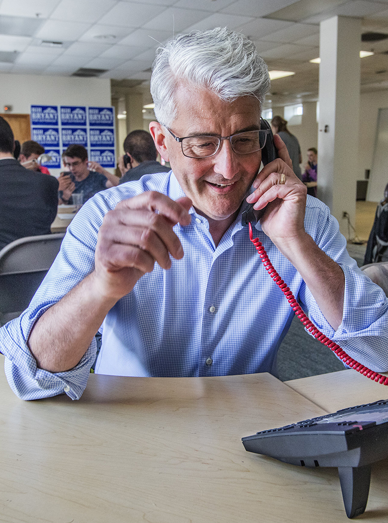 Republican Bill Bryant works at his Seattle campaign headquarters Tuesday, calling voters to find out if they've returned their ballots. (Steve Ringman/The Seattle Times)