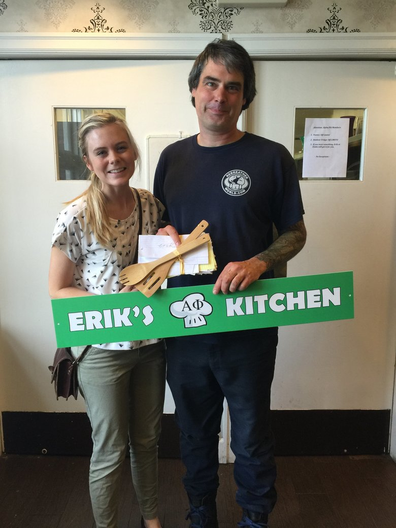 Alphi Phi member Elizabeth Rodland helps Erik Foreman celebrate his retirement in the spring after cooking for 19 years at the Alpha Phi house at the University of Washington. Foreman, 47, of Shoreline, died Monday while diving in Lake Huron in Michigan.  (Courtesy of Elizabeth Rodland)