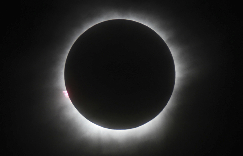 FILE – This March 9, 2016 file photo shows a total solar eclipse in Belitung, Indonesia. Hotel rooms already are going fast in Wyoming and other states along the path of next year's solar eclipse. The total solar eclipse on Aug. 21, 2017, will be the first in the mainland U.S. in almost four decades.   (AP Photo, File)
