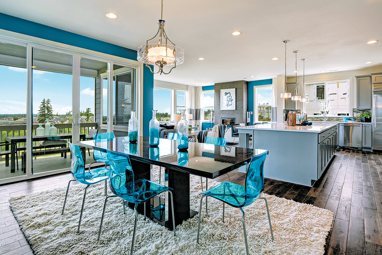 The Stuart with Basement floor plan at Canterbury Park includes expansive windows that overlook the yard and a covered deck off the great room.