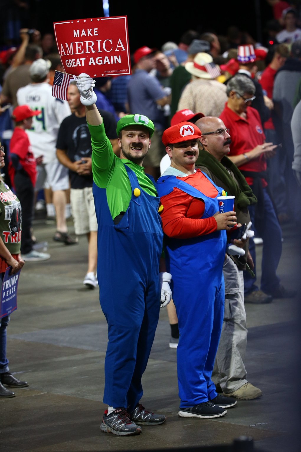 Donald Trump supporters dress as the Mario Bros.   (Dean Rutz / The Seattle Times)