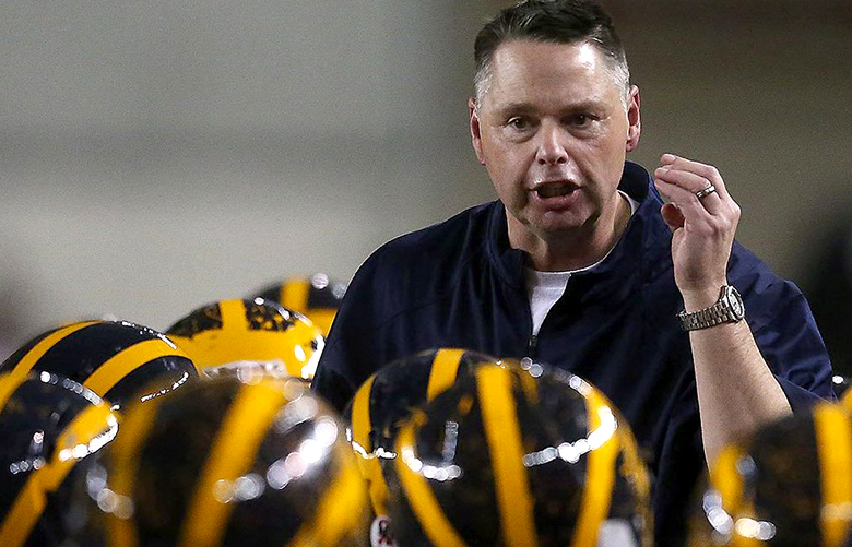 Bellevue's Head Coach Butch Goncharoff encourages his team to focus during a time out at the class 3A state football title game between Bellevue High School and Eastside Catholic High School at the Tacoma Dome, Friday, December 4, 2015. Eastside defeated Bellevue, 48-42.
