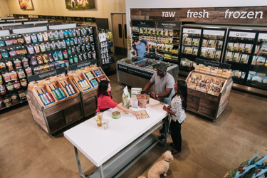 Petco has redesigned a number of its stores, including 12 in Seattle, to feature more neutral tones and to encourage more interaction with employees and other pet owners.  (Courtesy of Petco)
