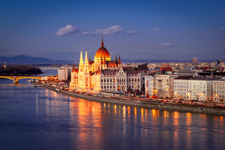 The Parliament glows at night in Budapest.