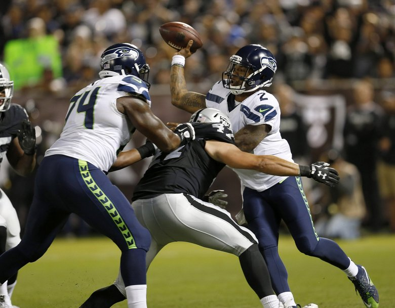 Seattle Seahawks quarterback Trevone Boykin (2) attempts to pass as he's pressured by the Oakland Raiders' James Cowser (47) during a play which resulted in a safety for the Raiders in the second quarter. (Jane Tyska/Bay Area News Group/TNS)