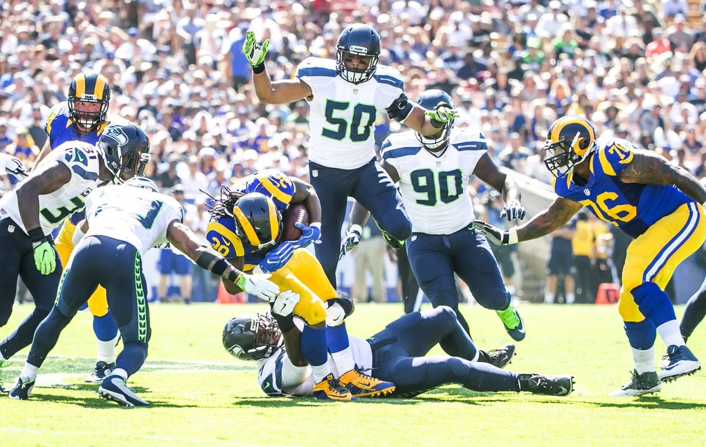 Los Angeles Rams running back Todd Gurley picks up a first down against the Seahawks defense in the  second quarter. (Bettina Hansen / The Seattle Times)