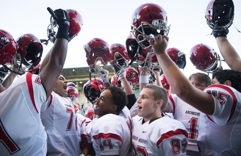 Archbishop Murphy celebrates their dominant win over Bishop Blanchet after the game at Memorial Stadium on Friday, Sept. 9, 2016. Archbishop Murphy mauled Bishop Blanchet, shutting them out 59-0. (Lindsey Wasson / The Seattle Times)