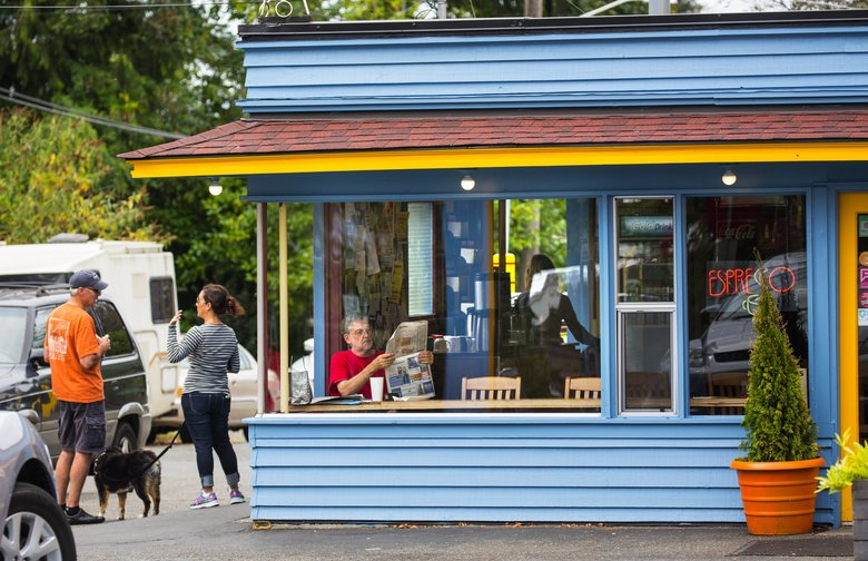 Folks hang out at the Cloud City Cafe on 88th and Roosevelt in Maple Leaf. The neighborhood has major arterials that are well-served by bus lines and also feature plenty of family-friendly small businesses, specialty stores and coffee shops. (Mike Siegel/The Seattle Times)