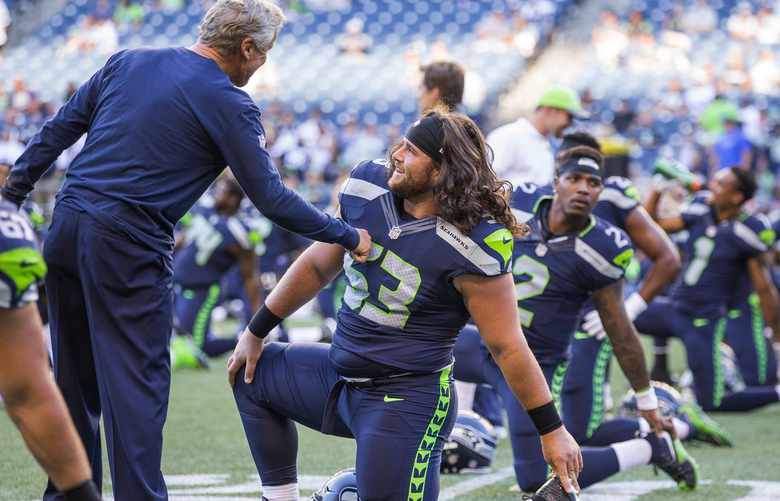 Pete Carroll talks to center Joey Hunt. The Dallas Cowboys played the Seattle Seahawks in preseason football Thursday, August 25, 2016 at CenturyLink Field in Seattle.