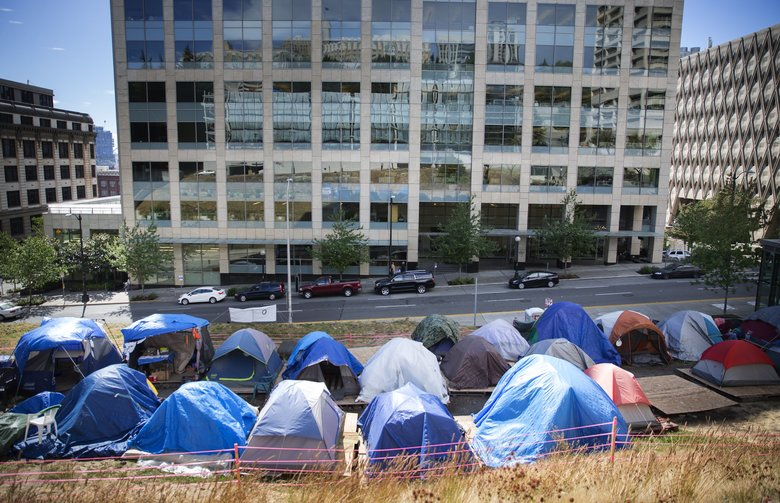 Tent City 7, on Goat Hill at Fifth Avenue and Jefferson Street in downtown Seattle, will soon be moved due to an agreement SHARE reached with King County and the city of Seattle on Friday, Sept. 2, 2016. Seattle Housing and Resource Effort, or SHARE, will received funding and reopen its indoor shelter network on Sept. 5.  (Lindsey Wasson/The Seattle Times)