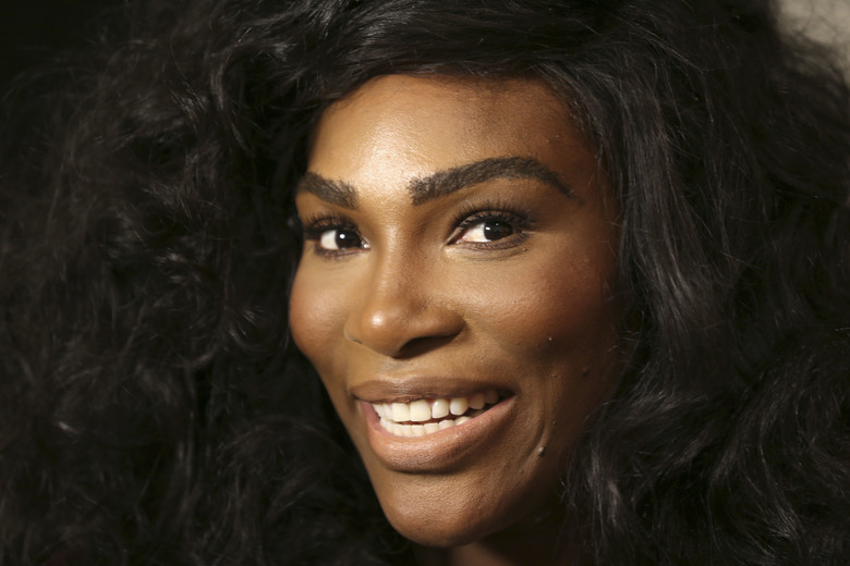Serena Williams speaks to reporters before showing her Serena Williams Signature Statement Spring 2017 collection during Fashion Week in New York, Monday, Sept. 12, 2016. (AP Photo/Seth Wenig)