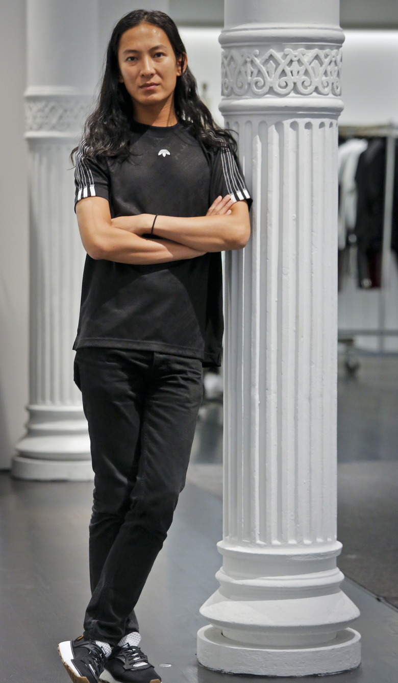"Fashion designer Alexander Wang pose in his studio Tuesday, Sept. 6, 2016, in New York. Wang will unveil his latest collection during Fashion Week, including his collaboration with Adidas– ""adidas Originals by Alexander Wang,"" (AP Photo/Bebeto Matthews)"