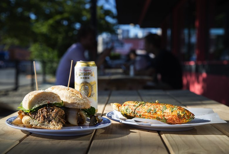 Paseo's most popular sandwich, the Caribbean roast pork, at the Sodo branch grand opening in July. (Lindsey Wasson / The Seattle Times)