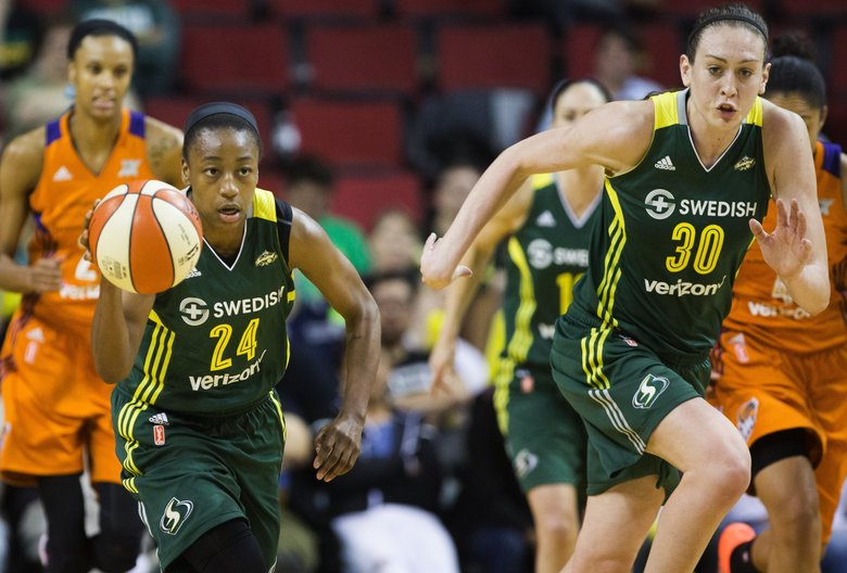 Seattle Storm guard Jewell Loyd drives up the court with Seattle Storm forward Breanna Stewart. (Lindsey Wasson/The Seattle Times)
