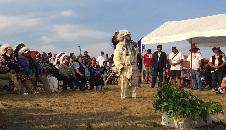 JoDe Goudy, chairman of the Yakama Nation, addresses the Standing Rock Sioux and tribal members from around the nation in Cannon Ball, N.D., in an effort to stop construction of an oil pipeline. Goudy is dressed in  (Yakama Nation)