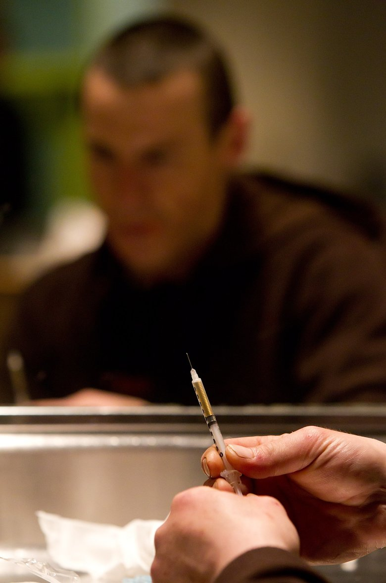 Richard Chenery prepares heroin at the Insite safe-injection clinic in Vancouver, B.C., in 2011.  (DARRYL DYCK/ASSOCIATED PRESS)