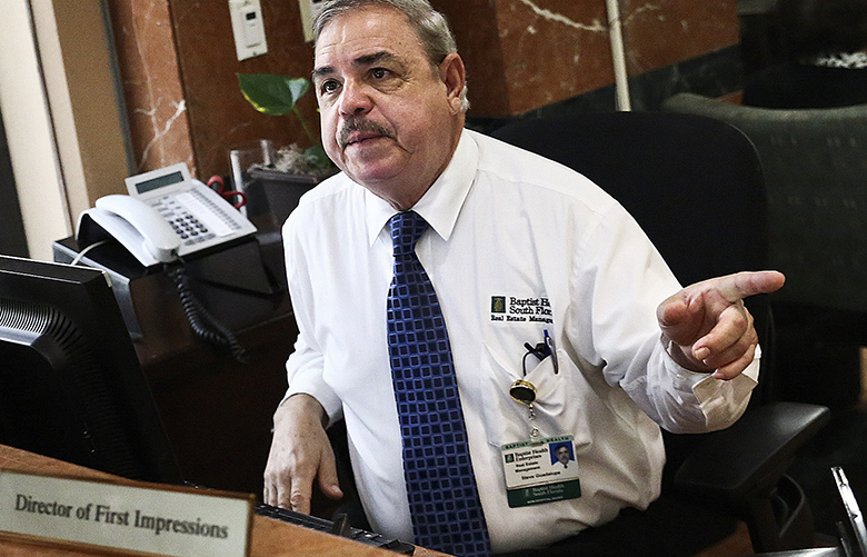 Steve Guadalupe, now 68, shifted from maintenance work at the Baptist Hospital of Miami to running the concierge desk. (Scott McIntyre / The New York Times)