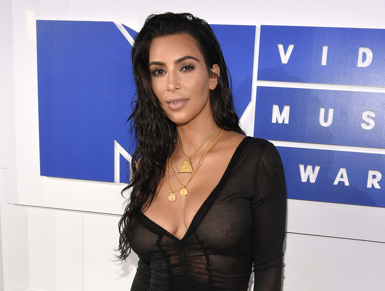 FILE – In this Aug. 28, 2016 file photo, Kim Kardashian West arrives at the MTV Video Music Awards in New York. Kardashian West is suing online media outlet, MediaTakeOut.com, saying she was wrongly portrayed as a liar and thief after she was attacked in Paris. Police say armed robbers forced their way into a private residence where Kardashian West was staying on Oct. 3, tied her up and stole $10 million worth of jewelry. (Photo by Chris Pizzello/Invision/AP, File)