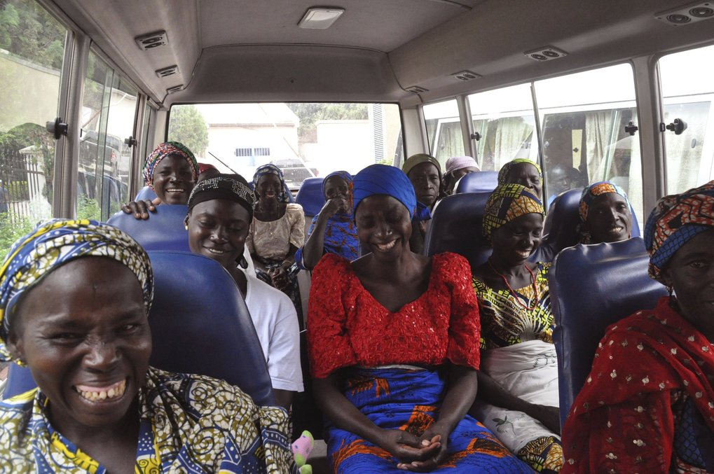Family members of the Nigerian Chibok kidnapped girls share a moment as they depart to the Nigerian minister of women affairs in Abuja, Nigeria, Tuesday, Oct. 18, 2016. Nigeria's government is negotiating the release of another 83 of the Chibok schoolgirls taken in a mass abduction two-and-a-half years ago, but more than 100 others appear unwilling to leave their Boko Haram Islamic extremist captors, a community leader said Tuesday.(AP Photo/Olamikan Gbemiga)