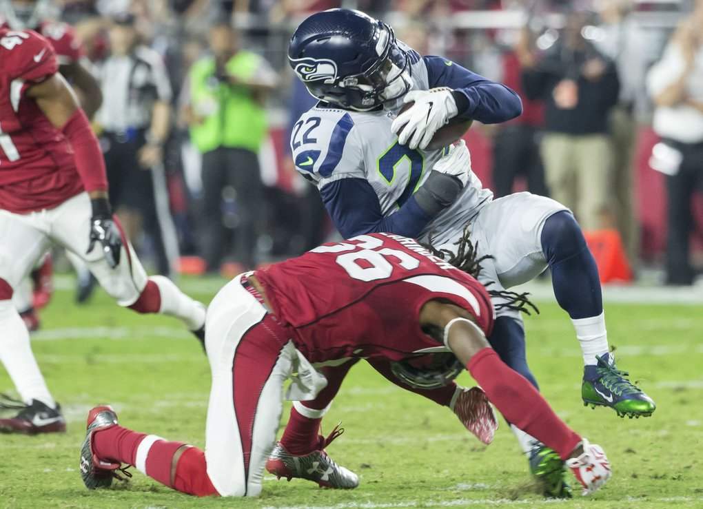 Seattle Seahawks running back C.J. Prosise (22) picks up 8 yards but it isn't enough so the Seahawks must punt during the third quarter. (Bettina Hansen / The Seattle Times)