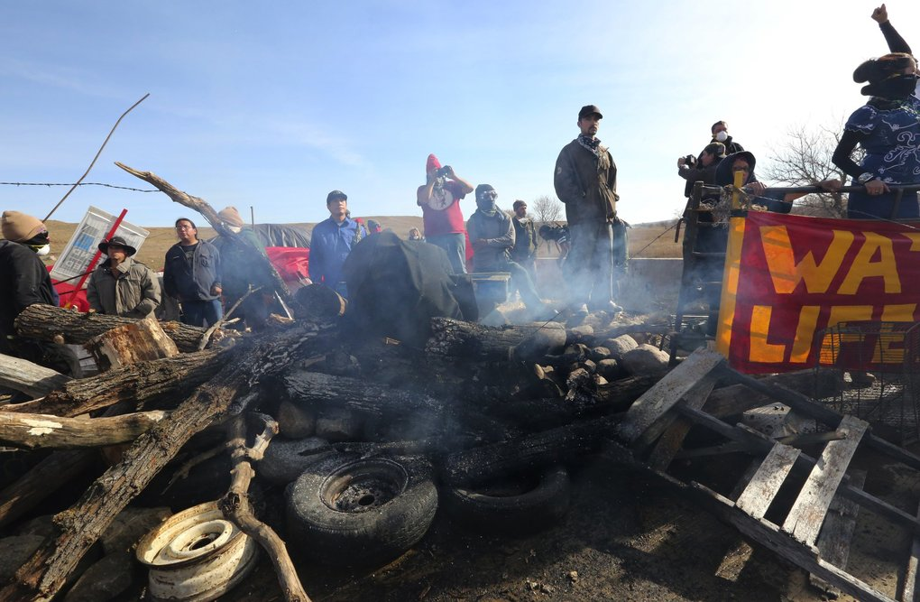 Protesters construct a barrier on a bridge on Morton County Road 134, not far from the main encampment, on Thursday.  (Alan Berner / The Seattle Times)
