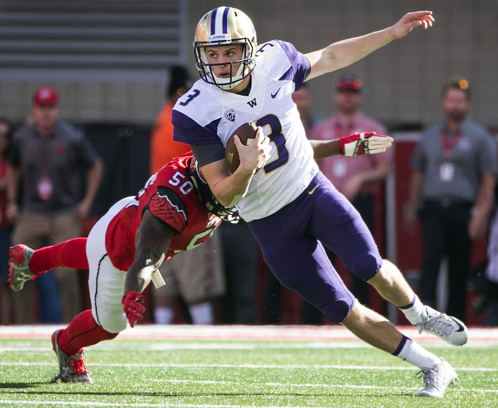 Washington Huskies quarterback Jake Browning (3) scrambles, but is sacked during the second quarter of Saturday's game against the Utah Utes at Rice-Eccles Stadium in Salt Lake City. (Johnny Andrews / The Seattle Times)