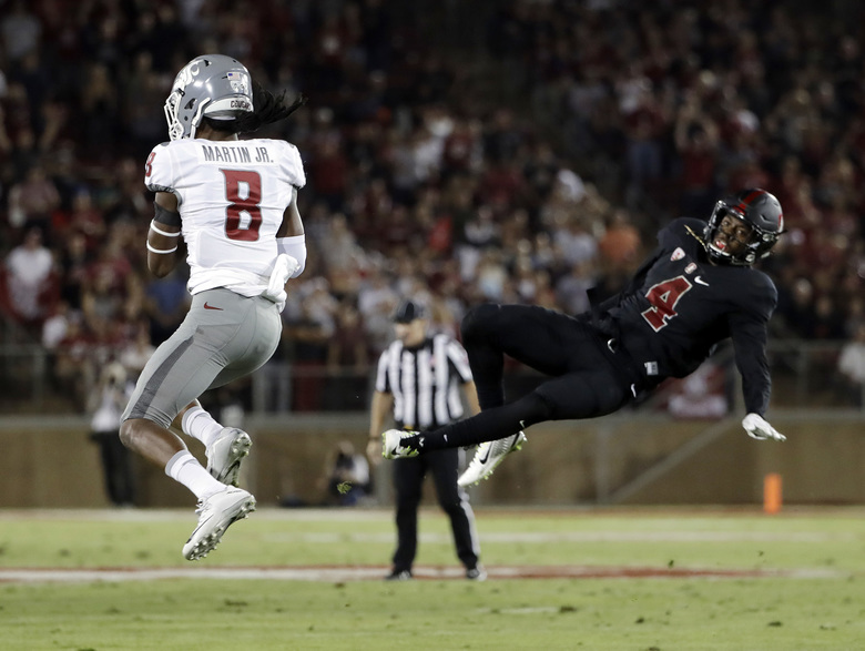 Washington State wide receiver Tavares Martin Jr. (8) makes a catch next to Stanford cornerback Frank Buncom (4) before running for a 29-yard touchdown during the first half of an NCAA college football game Saturday, Oct. 8, 2016, in Stanford, Calif. (Marcio Jose Sanchez/AP)