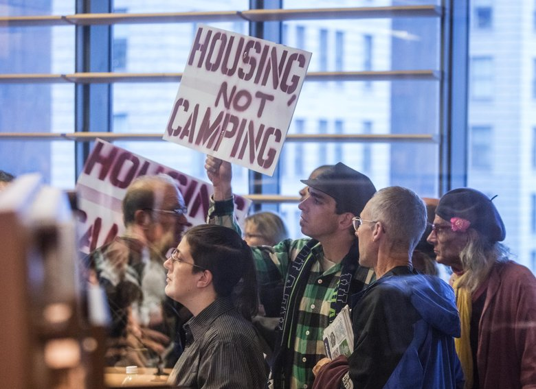 Friday, October 14, 2016. Part of the overflow croud outside the City Council chambers as inside the City Council committee discuss the proposal to allow homeless camping in public places.  (Steve Ringman/The Seattle Times)