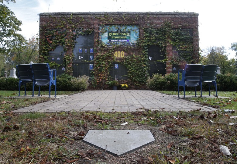 "A replica of Wrigley Field's outfield ivy walls, four stadium seats and a home plate called ""Beyond The Ivy,"" is the final resting place for the ashes of nine Cubs fans at the Bohemian Cemetery Wednesday, Oct. 19, 2016, in Chicago. The Wrigley Field themed mausoleum wall was the dream of Dennis M. Mascari, who's ashes are places just below the 400 feet marker. (AP Photo/Charles Rex Arbogast)"