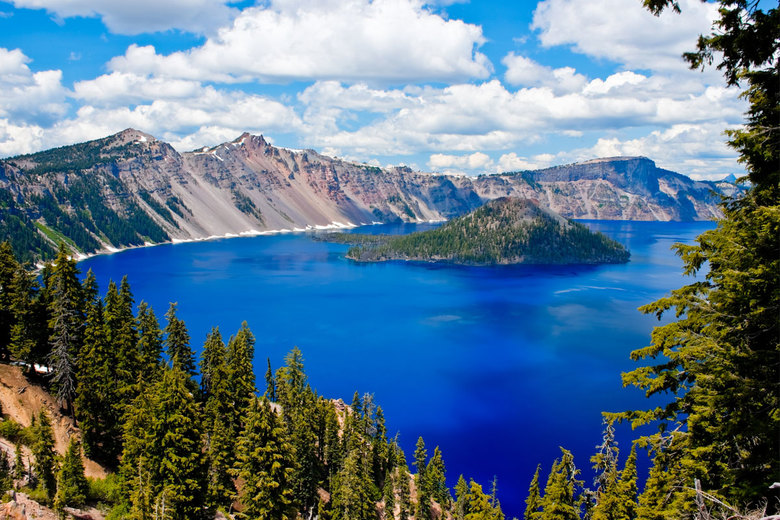 You can catch views of the bright blue waters of Crater Lake from the Rim Drive that circles the caldera. (Thinkstock)