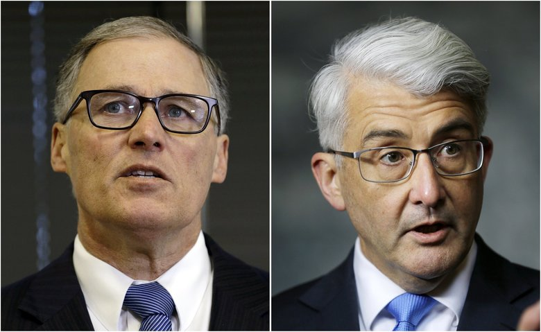 The race between Gov. Jay Inslee, left, and challenger Bill Bryant attracted more votes in Washington state than the presidential election did. (The Associated Press)