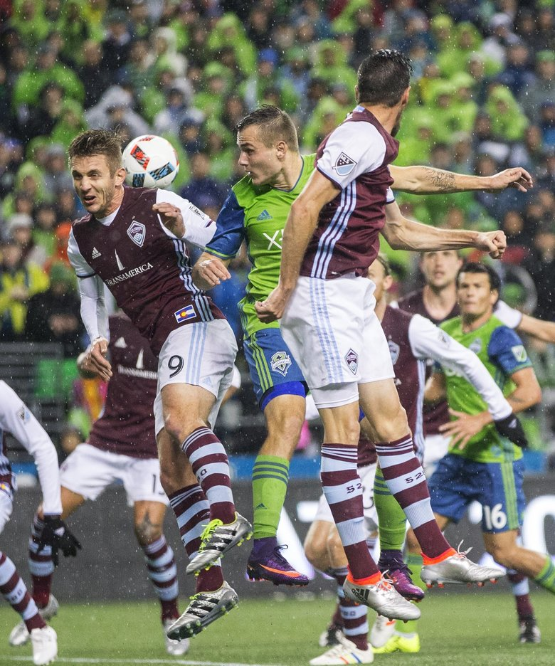 Seattle Sounders FC forward Jordan Morris (13) goes up for the header against Colorado Rapids forward Kevin Doyle during the first half in the first leg of the MLS Western Conference finals at Centurylink Field on Tuesday.  (Lindsey Wasson / The Seattle Times)
