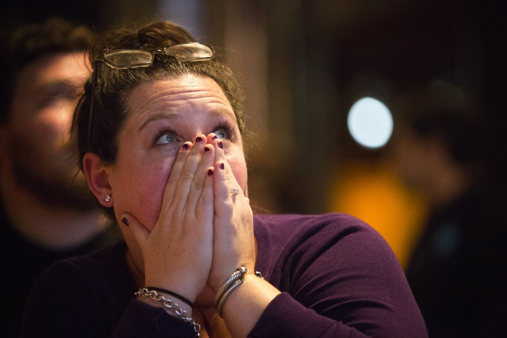 Jennifer Gans, visiting from Buffalo, NY., reacts as Hillary Clinton remains behind Donald Trump in the Florida count, at a gathering for congressional candidate Pramila Jayapal at Optimism Brewing Company in Capitol Hill. (Lindsey Wasson / The Seattle Times)