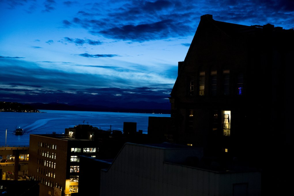 Lights inside offices and apartments illuminate the skyline as dusk settles onto downtown Seattle. (Erika Schultz/The Seattle Times)