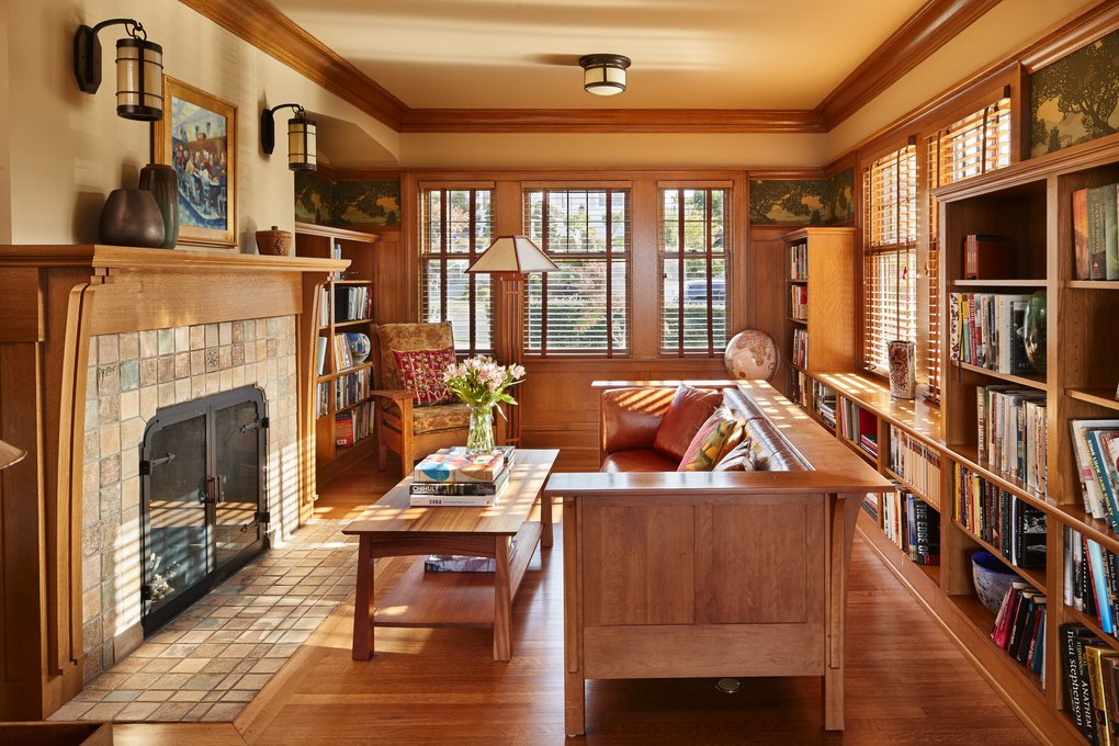 The library used to have a door to the entry and a door to the sunroom, architect Howard Miller says, but now it's happily and cozily contained, with new bookshelves, paneling, a custom mantel and a Craftsman motif frieze. Interior finishes throughout the home are by Jennifer Randall & Associates. (Benjamin Benschneider/The Seattle Times)