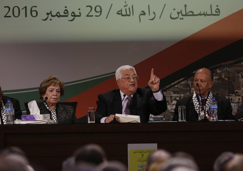 "Palestinian President Mahmoud Abbas speaks during the second day of the Fatah party conference, in the West Bank city of Ramallah, Wednesday, Nov. 30, 2016. Palestinian Fatah movement holds its seventh conference in Ramallah with some fourteen hundred members participating and led by Palestinian President Mahmoud Abbas. The conference is to elect the party's two main decision making bodies. Arabic reads "" Palestine, Ramallah, November 29, 2016."" (AP Photo/Majdi Mohammed)"