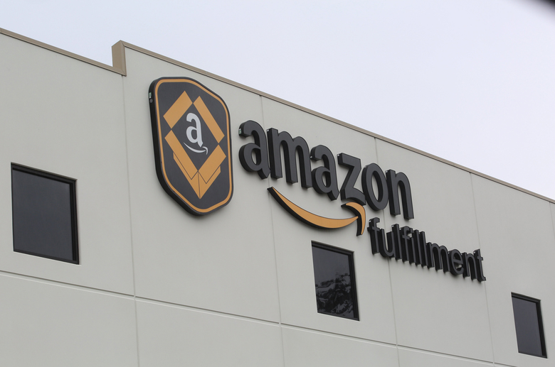 Amazon's fast-expanding warehouses and data centers could become growing sources of carbon emissions.  (Ellen M. Banner/The Seattle Times)