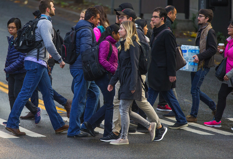 Pedestrians cross in the intersection of Westlake Avenue North at Denny Way.  (Mike Siegel/The Seattle Times, file)
