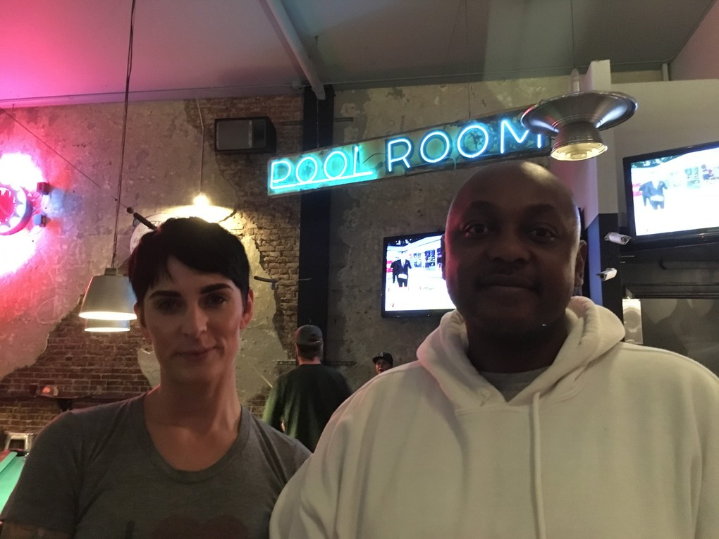 """At Temple Billiards in Pioneer Square, patron Sterling Beard and bartender Maria Coyier said they'd both """"voted blue"""" in this election. (Brendan Kiley / The Seattle Times)"""
