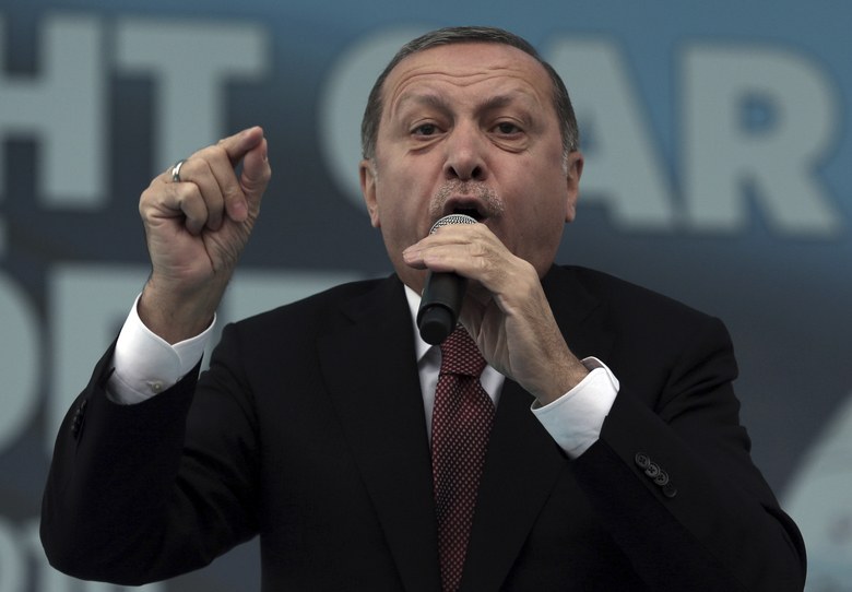 FILE – In this Oct. 29, 2016 file photo, Turkey's President Recep Tayyip Erdogan addresses his supporters during a ceremony for a new train station building on the Republic Day in Ankara, Turkey. Since quashing a July coup attempt, Turkey's president has used extraordinary powers from a state of emergency to arrest and purge thousands of opponents. Recep Tayyip Erdogan has also vowed to back public demands to reinstate the death penalty and suggested submitting Turkey's long-sought goal of European Union membership to a referendum. (AP Photo/Burhan Ozbilici, File)